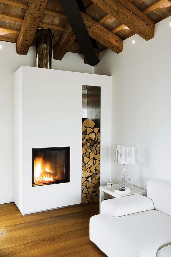 Luxury-Renovated-Farmhouse-couch-with-modern-fireplace
